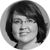 Black and white headshot of smiling female investment professional with short brown hair and glasses