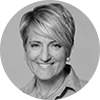 Circular black and white headshot of professional female mortgage officer smiling with short blond hair and light shirt
