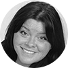 Circular black and white headshot of professional female mortgage officer smiling with long brown hair