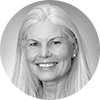 Circular black and white headshot of professional female mortgage officer smiling with long white hair