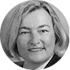 Circular black and white headshot of professional female mortgage officer with short blonde hair