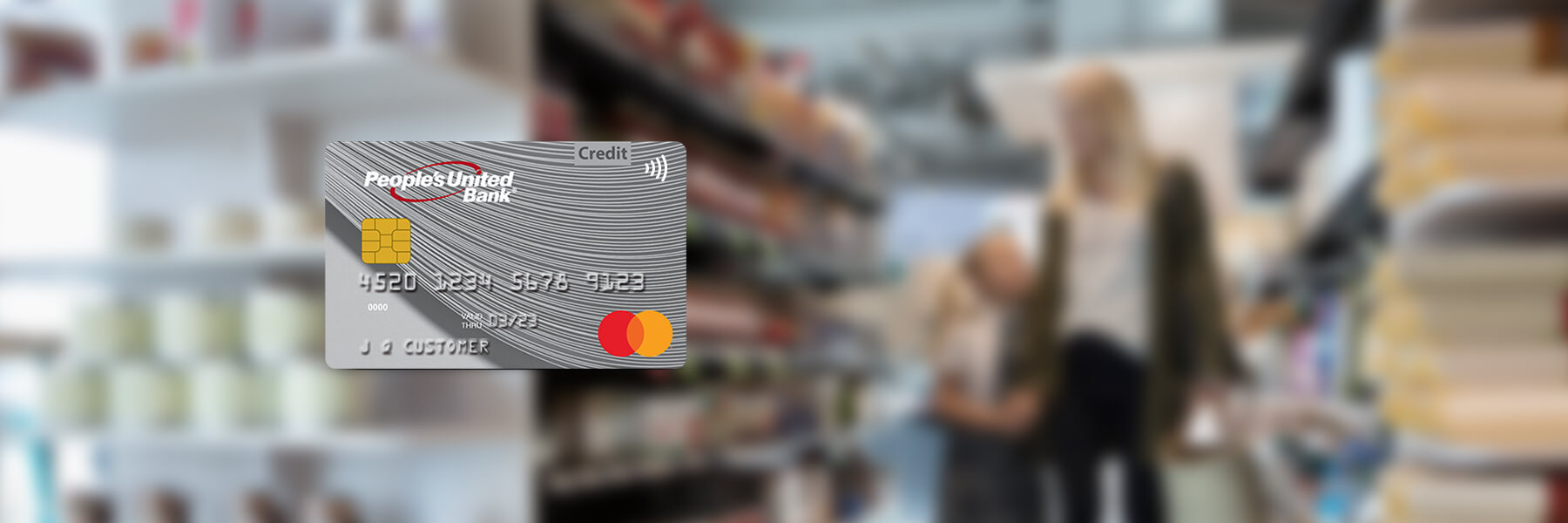 People's United Bank MasterCard Platinum personal credit card on top of a blurred background image of a mother and daughter shopping.