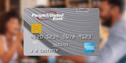 People's United Bank silver American Express® Credit Card on a blurred background of friends at a coffee shop