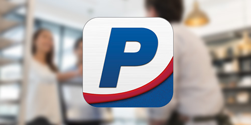 People's United Bank Mobile App logo on top of a blurred image showing at a retail checkout counter